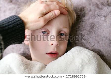 Menino cama pequeno amarelo estrela Foto stock © derocz