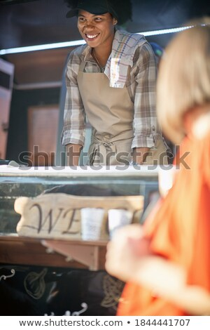 Vertical image of young woman in eatery Stock photo © deandrobot