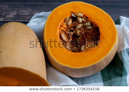Close up of healthy pumpkin seeds and pumpkin against colorful autumn accents Stock photo © klsbear