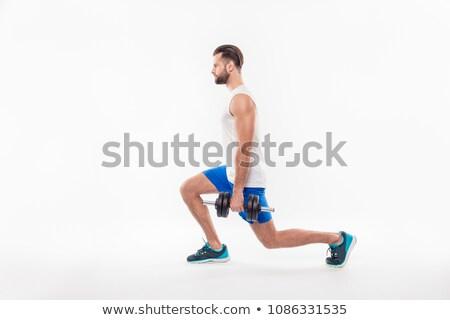 Oldalnézet komoly egészséges fiatal sportoló ablakpárkány Stock fotó © deandrobot