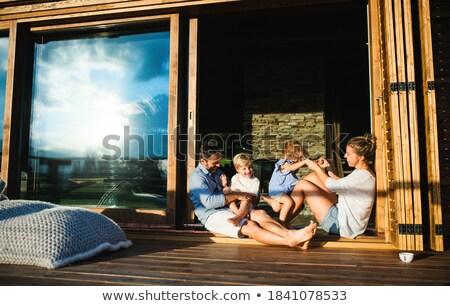 Lány fiú ül kívül belső udvar nő Stock fotó © IS2