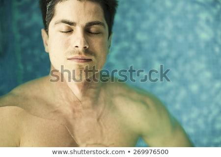 Moço flutuante água homem verão piscina Foto stock © IS2