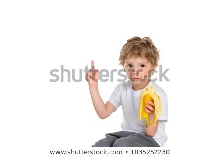 Little caucasian boy pointing his forefinger up. Stock photo © RAStudio