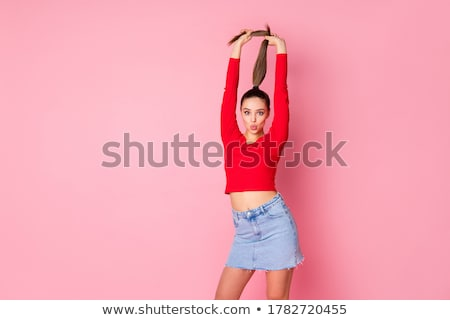 Girl with red tails on a pink background. A charming girl in bright sports clothes, sunglasses and h Stock photo © Traimak