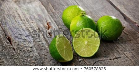 Fresh lime on wood board, bio fruit Stock photo © Peteer