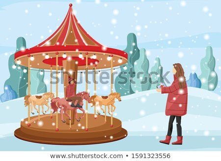 Mother with son and carousel on Christmas market Stock photo © Kzenon