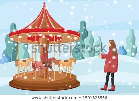 mother with son and carousel on christmas market stock photo © kzenon