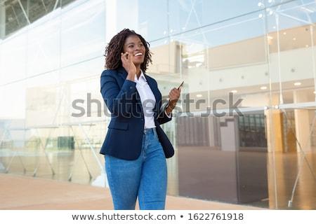 fiatal · afroamerikai · üzletasszony · mobiltelefon · portré · iroda - stock fotó © boggy