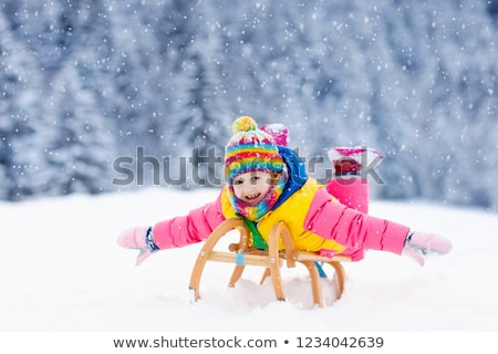 happy little girl on sled outdoors in winter Stock photo © dolgachov