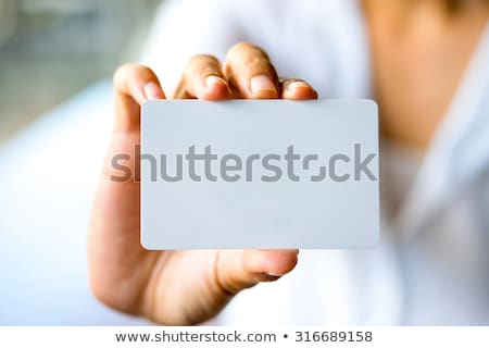 business woman holding company card Stock photo © 3dmask