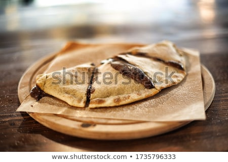 Homemade calzone on the plate Stock photo © Alex9500