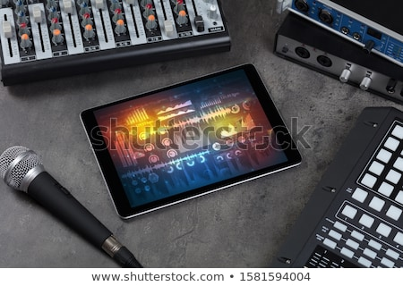 Electronic music instruments and tablet with reports concept Stock photo © ra2studio