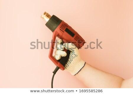 Inşaat araç saç kurutma makinesi erkek el beyaz Stok fotoğraf © OleksandrO