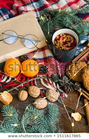 Hot tea with lemon and lingonberry leaves and other food and symbols of xmas Stock photo © pressmaster