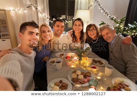 happy family taking selfie at tea party at home Stock photo © dolgachov