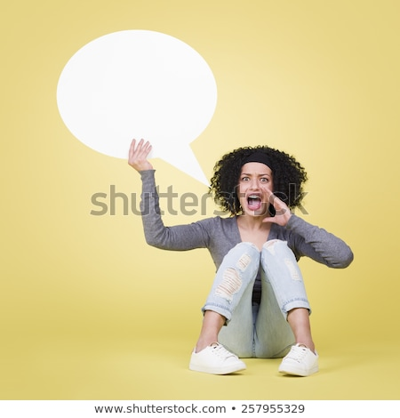 Upset girl holding a white speech balloon with copyspace. Stock photo © lichtmeister