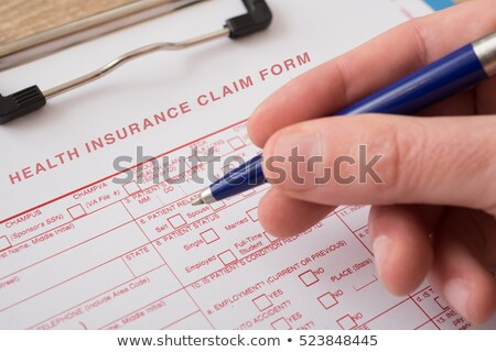 File the health insurance claim form with a pen Stock photo © johnkwan