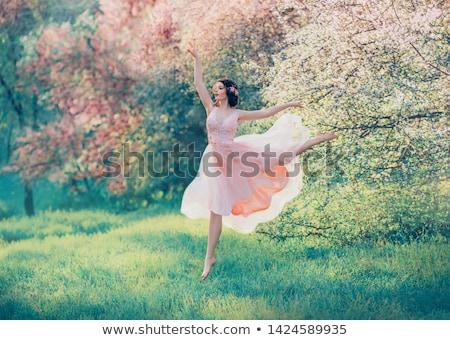 красивая женщина цветения саду женщину розовый платье Сток-фото © ElenaBatkova
