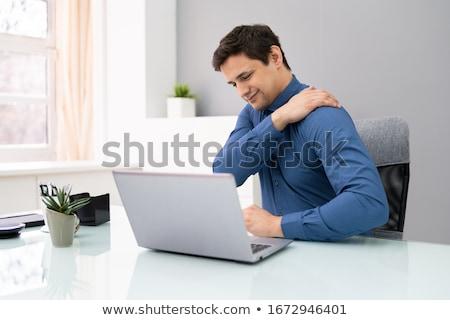 Işadamı omuz ağrısı genç çalışma bilgisayar Stok fotoğraf © AndreyPopov