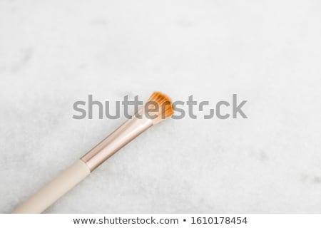 Make-up brush for foundation base face contouring on marble back Stock photo © Anneleven