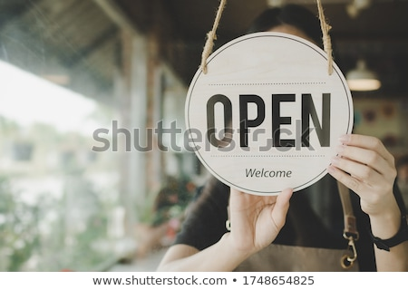 Open sign on the glass of the door at store Stock photo © boggy