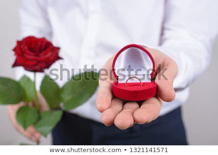 man giving diamond ring to woman at restaurant Stock photo © dolgachov