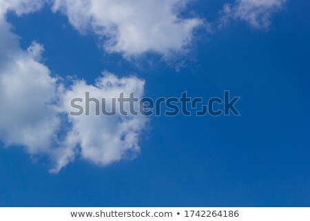 fluffy clouds background on blue skye design Stock photo © SArts