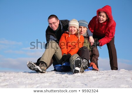 two friends push two of others on sleighs Stock photo © Paha_L