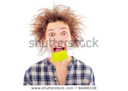 Portrait of funny young man with awesome hairdo isolated on whit Stock photo © HASLOO