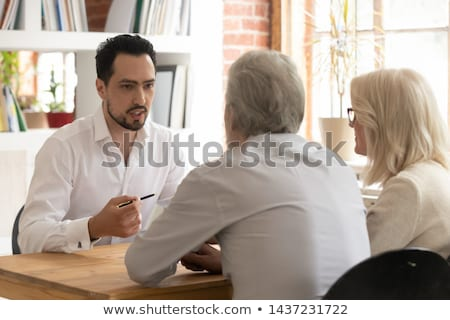 Grey-haired man giving advise Stock photo © photography33