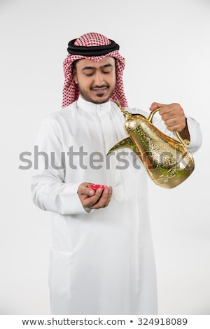 smiling ethnic arab man with coffee stock photo © lovleah