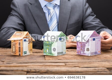 Businessman with a house made out of Euros Stock photo © photography33