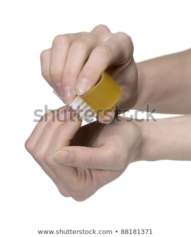 cleaning nails with a scrubber Stock photo © prill