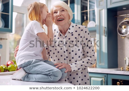 girl whispering a secret to her grandmother stock photo © photography33