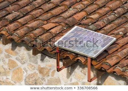 Solar cells on an old house Stock photo © elxeneize