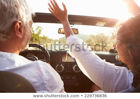 Mature woman having fun in Convertible Car  Stock photo © tab62