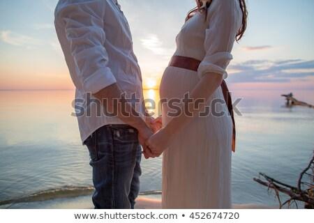 Hamile çift sevmek plaj gökyüzü el Stok fotoğraf © koca777