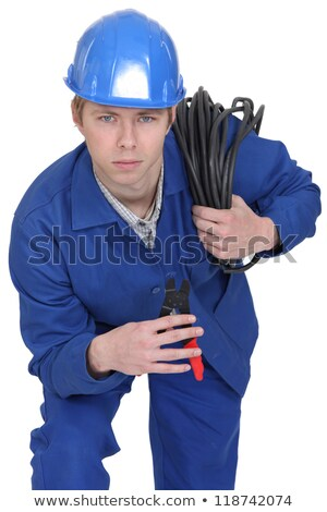 Electrician brandishing electrical clippers Stock photo © photography33