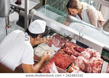 man · werken · winkel · tonen · vlees · slager - stockfoto © Kzenon
