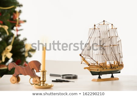 vintage wooden horse and ship on santas work table christmas t stock photo © hasloo