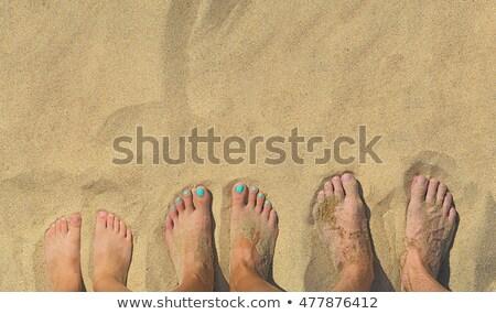 Pieds famille sable enfant signe jambes Photo stock © meinzahn