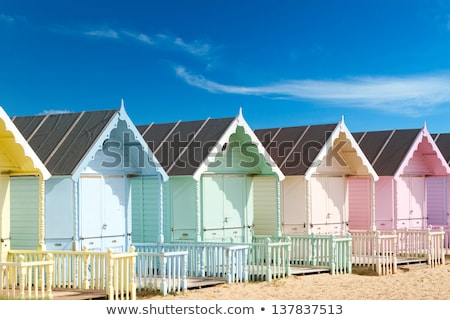 Row of colorful wooden beach huts Stock photo © photohome