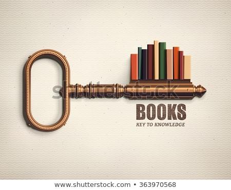 Old metal key on vintage book. Stock photo © Nejron