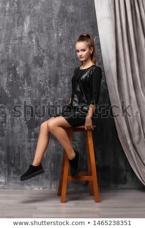 rock style girl sitting on stool stock photo © filipw