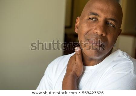 Homem negro dolorido pescoço jovem homem cabelo Foto stock © fouroaks
