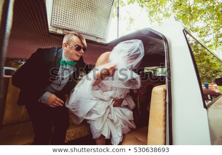 Beautiful blonde stepping out of limousine Stock photo © wavebreak_media