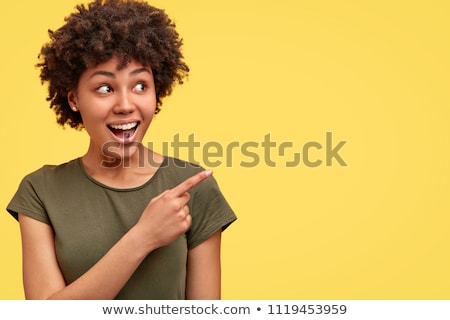 afro american woman pointing finger away stock photo © deandrobot