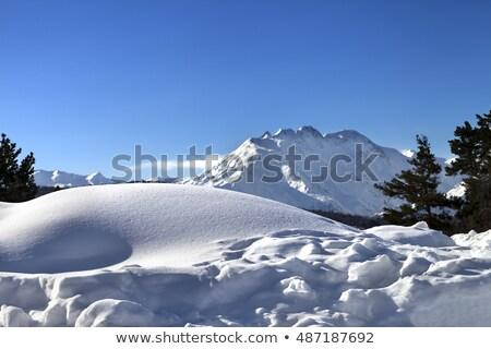 Hegyek hóesés hegy tájkép felhős nap Stock fotó © Kotenko