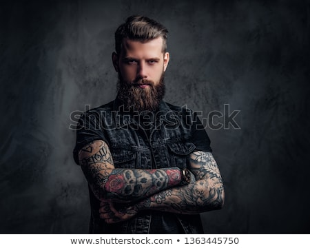 dark portrait of handsome rocker posing in studio background  Stock photo © feedough