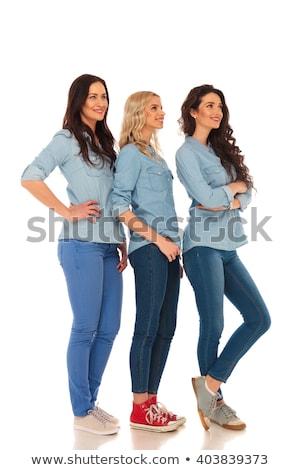 Egészalakos három fiatal boldog nők pózol Stock fotó © feedough